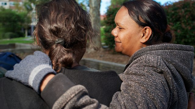 Aboriginal Woman with her arm around a Friend